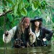 Jack Sparrow stands in the water with Blackbeard's daughter (Penelope Cruz).